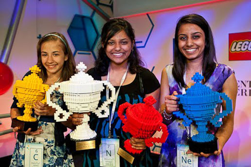 2011's winners holding their unique Lego trophies