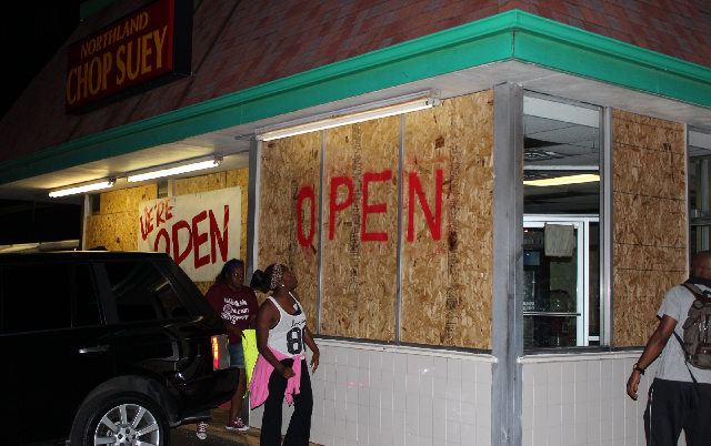 Business damaged in looting several days prior